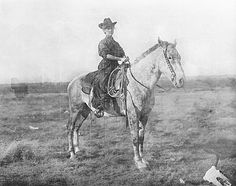 """Erwin Smith Collection - Carter museum.   1905 """"Gussie"""" Sanders, cousin of the photographer, riding astride with what looks like a full skirt, on the Three Circles Ranch in Texas:She could be wearing """"Bloomers"""" under the skirt, or it may be split, it's hard to tell, but it's obvious that the trail of the skirt comes far down and covers her ankles quite thoroughly."""