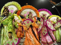 Performers from Unidos de Vila Maria samba school perform a dance honoring Korean immigrants in Brazil.