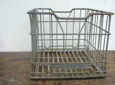 My garage sale find of the weekend...now what to do with it! :) Metal Milk Crate