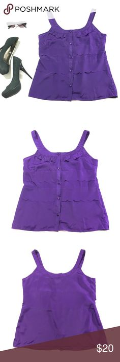 "Ruby Rose Purple Tank A night out is the perfect place to wear this simply charming top. Ruffled embellishments at the neck and waist combined with a five button front mean that looking great is easy in this no nonsense top. Size Large, Measurements: (measured laying flat) 18"" bust, 24"" shoulder to hem, 18"" nape to hem. Ruby Rose Tops Tank Tops"