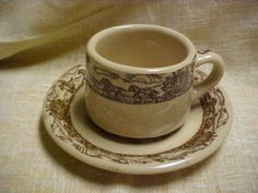 """Vintage 1950's Tepco Western Traveler Cup and Saucer Set in the tan colored clay w/brown transfer. This cup measures 2-1/2"""" tall and 3-1/4"""" across the top. The saucer is 6"""" wide"""