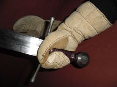 Handmade medieval gloves. They are made entirely of leather, and are triple padded for better protection. Perfect for medieval fights.