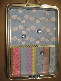 Cookie Sheet Magnet Board. Made these at our ladies craft night with fabric and mod podge. No need for drilling holes.  Just hot glue a loop on back and a bow on front.  That makes it look like the ribbon goes through.