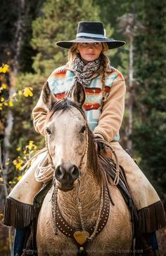 Great hat and coat. Good lookin horse too...