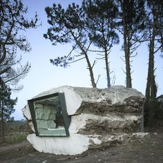 Interesting concept....This cave home was built by pouring concrete over stacked hay bales, cutting an opening, and then letting a cow in to eat the hay