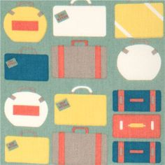 blue grey birch organic fabric with colourful suitcases