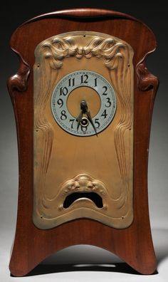 Art Nouveau Mantle Clock, 1901, Lenzkirch Clock Factory, Germany, brass and mahogany, H: 15-11/16 in., retailed by Tiffany & Co.