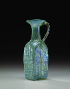 Roman glass pitcher, century A. Body blown in a mold with four parts and separate base plate and applied handle, decorated, cm high. Corning museum of glass Corning Museum Of Glass, Glass Museum, Glass Vessel, Glass Art, History Of Glass, Vases, Roman Art, Vintage Bottles, Ancient Artifacts