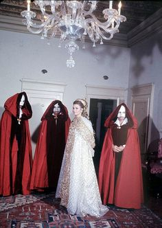 """Princess Grace (in white and gold Dior gown) came with three """"princes"""", one of whom is her husband, Rainier, photo by Loomis Dean at the Venice Ball, Venice, Italy, Sept. 1967 