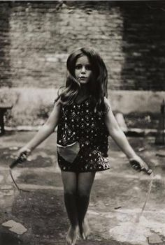 I really like Diane Arbus' photography because it is very different and interesting. Instead of capturing peoples' smiles, she creates an almost eery feel in her photos with the use of the contrast, colors, the body language and facial expressions of the subjects.