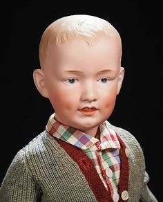 Marks: Heubach (sunburst mark) Germany 8 7620. Comments: Gebruder Heubach,circa 1912. Value Points: rare model in fine larger size with super modeling of eyes,mouth,impressed cheek and chin dimple,original body finish,wonderful school boy costume.