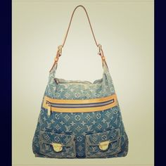 Blue Denim Louis Vuitton monogram bag. This slouchy Louis Vuitton Blue Denim Monogram Baggy GM bag is the ideal hobo to sling on your shoulders. It is crafted from monogram denim with beige leather trim and gold-tone hardware. It features a top and front zip closure and two front flap pockets. The interior is lined with alcantara with one patch pocket. Louis Vuitton Bags