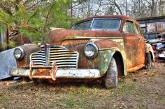 Photo about Junk yard vehicles showing old rusted car in overgrown weedy area. Image of junk, close, glass - 21208092 Vintage Cars, Antique Cars, Abandoned Cars, Abandoned Vehicles, Cool Old Cars, Rust In Peace, Rusty Cars, Old Classic Cars, Train Car