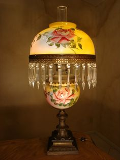 Beautiful Oil Lamp with the globe in the middle of the bronze stand having hand painted roses on it. The shade is beautiful with hand painted roses and prisms hanging from the bottom Antique Oil Lamps, Antique Lighting, Vintage Room, Vintage Lamps, Victorian Lamps, Victorian Bedroom, Victorian Furniture, Old Fashioned House, Hurricane Lamps