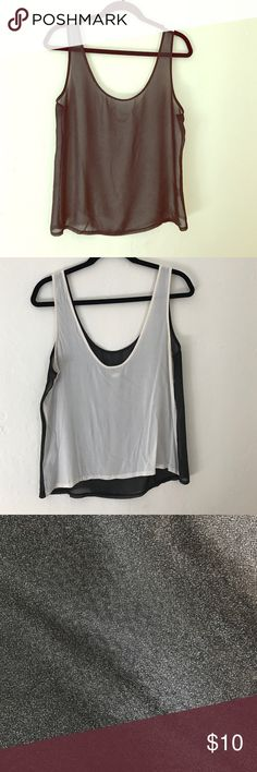 Two tone tank Front is black, back is ivory.  Subtle sparkle in black fabric.  Relaxed fit. 100% poly front, 100% rayon back Ali & Kris Tops Tank Tops