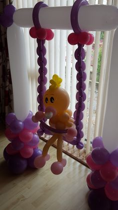 Baby on a swing. Great #babyshowerballoons from www.cardiffballoons.co.uk