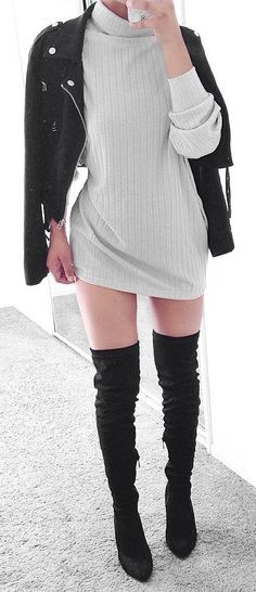 mixing the collest sweater dress with a black jacket