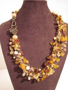 Crocheted citrine, Swarovski, pearls, amber, cloisonne, brass toned metal leaf toggle closure