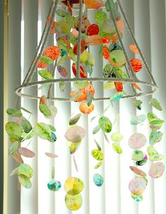 Remember melting crayon shavings between 2 pieces of waxed paper?  After melting, cut the paper into circles and hang to create a colorful hanging decoration