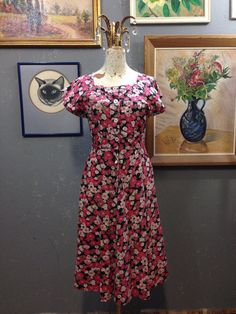 30's floral feed sack dress. Buttons are mixed, plastic, glass, and at least one shell.