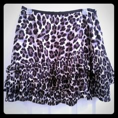 dkny leopard skirt  New with tags never worn. side zipper. DKNY Skirts
