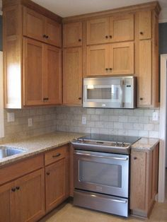 area above kitchen cabinets in the kitchen kraftmaid sedona maple praline labrador 4173