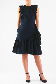 Ruched pleating at the banded crew neck begins our ruched and ruffled cotton poplin dress thats flowy and feminine with ruffles cascading down the faux-wrap skirt.
