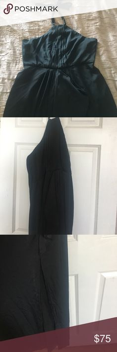 BCBG black satin gown NWT New with tags. Black satin gown. Halter strap around neck. Ruffle in the front. Slit to the knee in the front middle of the dress. Classy long gown. Sexy open back. BCBGMaxAzria Dresses Prom