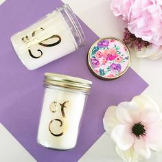 """Monogram Mason Jar Candle. Monogram Mason Jar Candles are practical and unique gifts to give the girls in your bridal party! Each candle comes in a heavy glass mason jar with a gold custom monogram and floral gold lid. Candles are made of 100% soy wax and have a floral/citrus scent. You will receive one monogram candle in a mason jar with a custom gold monogram of your choice and floral gold lid. NO OTHER ITEMS INCLUDED. Burn time: Approximately 45 Hours. Size: 3 7/8"""" x..."""