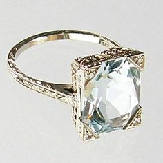Aquamarine Ring c. 1920. There aren't words to describe how much I need this. Neeeeeeeeed.