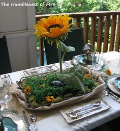 Blogger says: The 'Magic' Sunflower standing in the faux grass was super easy -- after I learned this fun trick from Jonathan Fong of Style with a Smile TV. All it takes is a metal surface (in this case, a gorgeous Covington Tray) and a magnet hot glued to the base of the flower stem (for fresh flowers you'll need to glue the magnet to a flat head nail and insert the nail into the flower stem). I've used Gerbera Daisies with great success,
