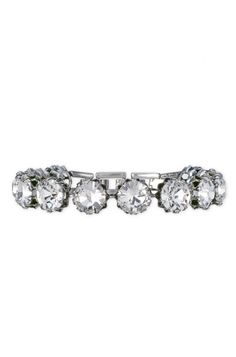 Catch everyone's eye at the party in this crystal tennis bracelet from Stella & Dot. Elegant glamour meets heirloom appeal in one stunning silver bracelet.