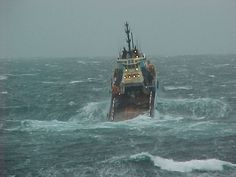 sea storm wave boat scottish oil rig north sea