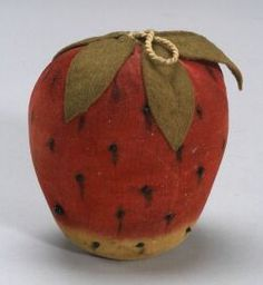 "Large Velvet Strawberry Pincushion, America, early 19th century, with felt leaves and black glass straight pin ""seeds,"" lg. 5 in."