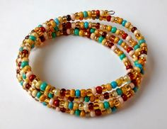 Teal, Gold and Cream Colored Memory Wire Bracelet                                                                                                                                                                                 More