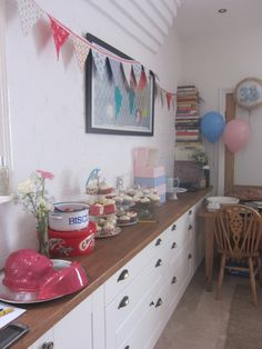 Our kitchen - handmade party bunting gives it a cottage feel!