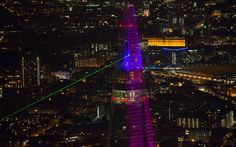 The Shard is lit by a laser light show during the building's inauguration in London, England, on July 5, 2012. At 310 meters or 1,017 feet, the Shard is the tallest tower in the entirety of Europe.