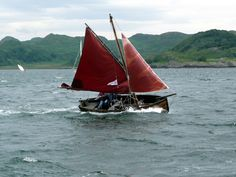 Mike and Daphne Murray gaff-rigged dinghy in a half gale off Crinan, Scotland. -scottishboating: the evolution of small boat types.