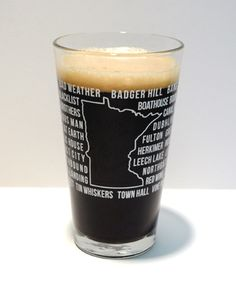 """Show your Minnesota pride and your love of local breweries with the Minnesota """"State of Beer"""" pint glass from The 16 oz Society. Features 57 of Minnesota's Finest breweries.  Including:   612 Brew, Dangerous Man, Lift Bridge, Bad Track, Dubh Linn, Lucid, Bad Weather, Dubrue, Mankato, Badger Hill, Excelsior, Mantorville, Bang, Fair State, Northbound, Barley John's, Fitger's, Northgate, Bemidji Flat Earth, Olvalde Farm, Bent Paddle, Fulton, Pour Decisions, Big Wood, Grea..."""
