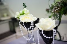 Roses and freesia and dripping.  http://flowersvalentinesday.blogspot.com/2012/05/black-white-wedding-bouquet-table.html