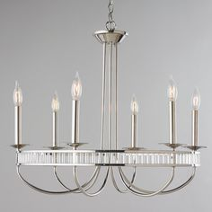 A modern twist on this metal chandelier will fit into any decor. Available in Polished Chrome or Aged bronze this chandelier features 6 candelabra style arms. A metal band surrounds the chandelier with just the right amount of candelabra style base max. Cool Chandeliers, Metal Chandelier, Chandelier Shades, Entryway Lighting, Dining Room Lighting, Exterior Lighting, Kitchen Lighting, Glass Pendant Light, Pendant Lighting