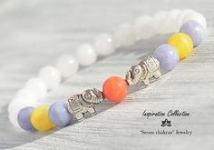 White quartz bracelet Abundance elephant Gemstone Bracelet Womens Beads Bracelet White quartz Gemstone Healing Jewelry. To make this bracelet I used seed beads of white quartz, lavender, yellow and orange jade beads, spacers beads and two beads elephant abundance.  Size of beads: 8mm   → The jewelry I make with inspiration and lots of love ♥ you can be sure that they will bring you only positive energy and good mood ☼♪:) → IMPORTANT   To select the bracelet size, measure wrist with measuring…