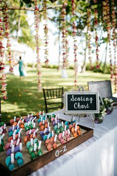 Seating chart sign, colorful mini flip-flops in sand, beach-themed escort cards // Makai Creative Baby Shower Themes Neutral, Sand Beach, Seating Charts, Beach Weddings, Beach Themes, Wedding Vendors, Wedding Photos, Flip Flops, Villa