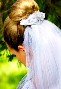 Bride's looped bun with under veil bridal hair Toni Kami Wedding Hairstyles ♥ ❷ Wedding hairstyle ideas
