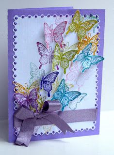 Stamp a few directly onto the front of the card, but first stamp off some of the ink so that they are pale, and then stamp the fussy cut butterflies with full strength ink to create a 3d effect. Use crystal stickles to cover all of the wings of the fussy cut butterflies.
