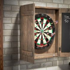 Show off your impressive woodworking skills this weekend by creating a homemade Dart Board Case. Dartboard Cabinet Plans, Outdoor Dart Board, Furniture Projects, Wood Projects, Ping Pong Room, Air Hockey, Hockey Pool, Dart Board Cabinet, Ideas