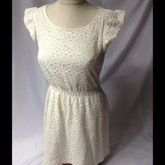 """Boutique brand JJ authentic lace dress small Boutique brand """"JJ authentic"""" lace dress with cap sleeves. Size is medium but it runs small so more like a small. FLAW....there is one nick in the lace just above the waistband to the left size as pictured. Off white, cream/Ivory. JJ Authentic  Dresses Mini"""