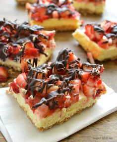 Lighten up your dessert with these Strawberry Cheesecake Bars with Pretzel Crust drizzled in rich dark chocolate. The kids will love this sweet treat and you can make them in a snap!