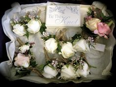 Stephanie Ellen Designs... Buttonholes with roses, wax flower, astilbe and tied with twine