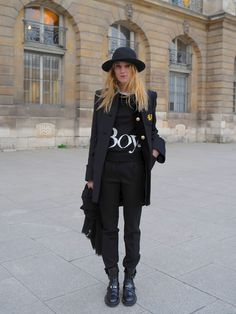 "all black and no boring. fab androginy style! all you need is the key stuffs : long coat & ""it"" boots."